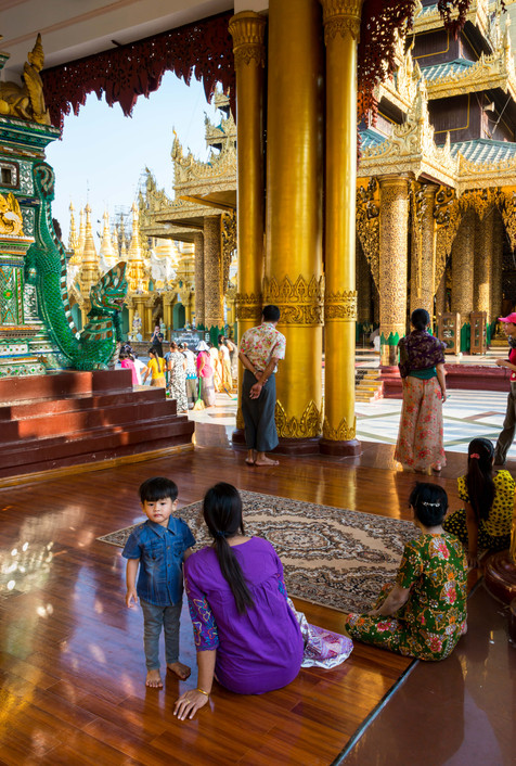 Mother and Son - Inside the Shwedagon Pagoda, Yangon. The holiest temple in Myanmar