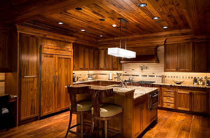 A photograph of a beautiful wood paneled architectural kitchen -architecture photography - Vail, Colorado.jpg