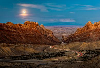 Full Moon Rising Behind The San Rafael Swell at Sunset - Utah