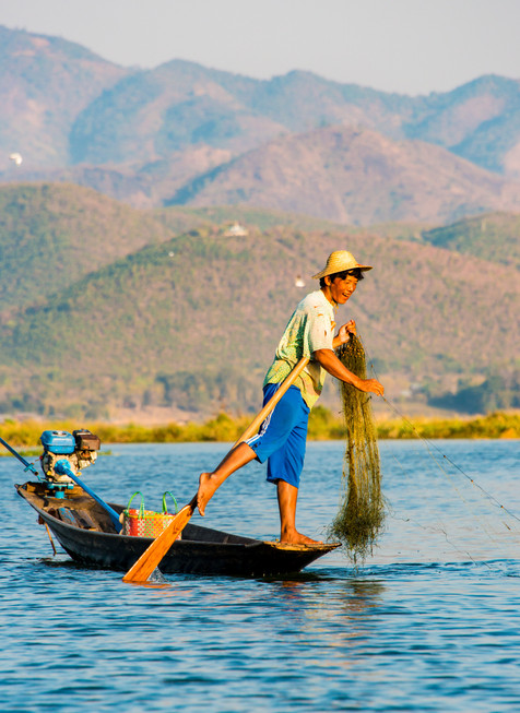 A Happy Fisherman at Sunrise - Inle Lake, Myanmar