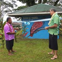 Cutting the ribbon Malololelei mural.jpg