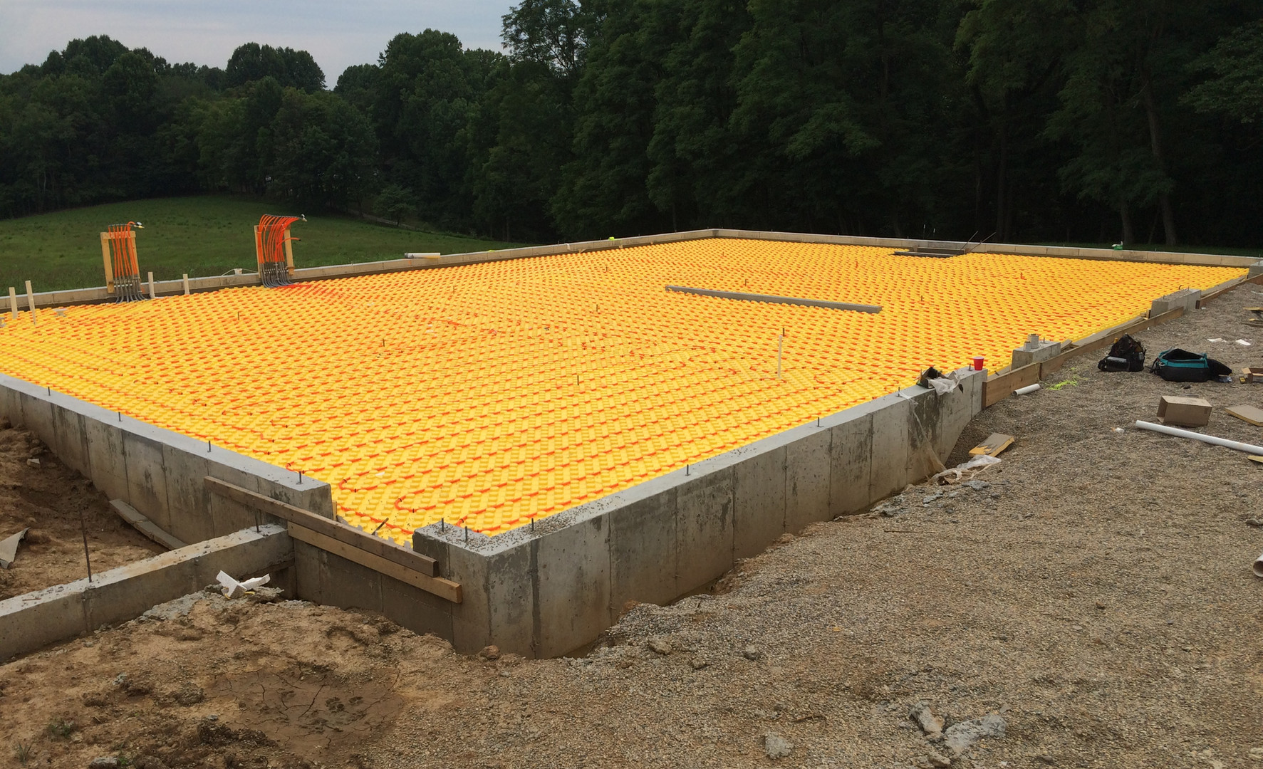 Radiant floor heating rough-in before concrete pour