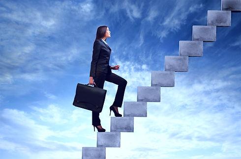 Businesswoman%2520stepping%2520up%2520a%