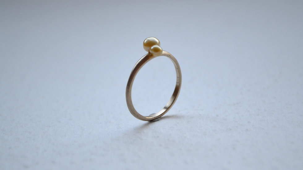 Twin gold pearl ring