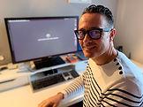 Adam in office.jpg