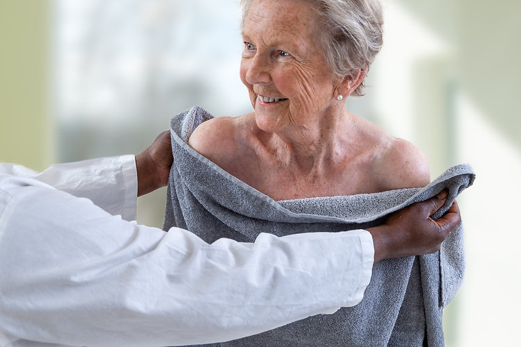 Care giver or nurse assisting elderly wo