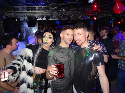 Smiling guys and drag queen