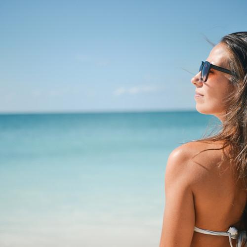 Women enjoying luxury beach travel