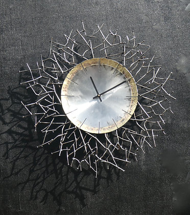 CLOCK WITH RECYCLED NAILS