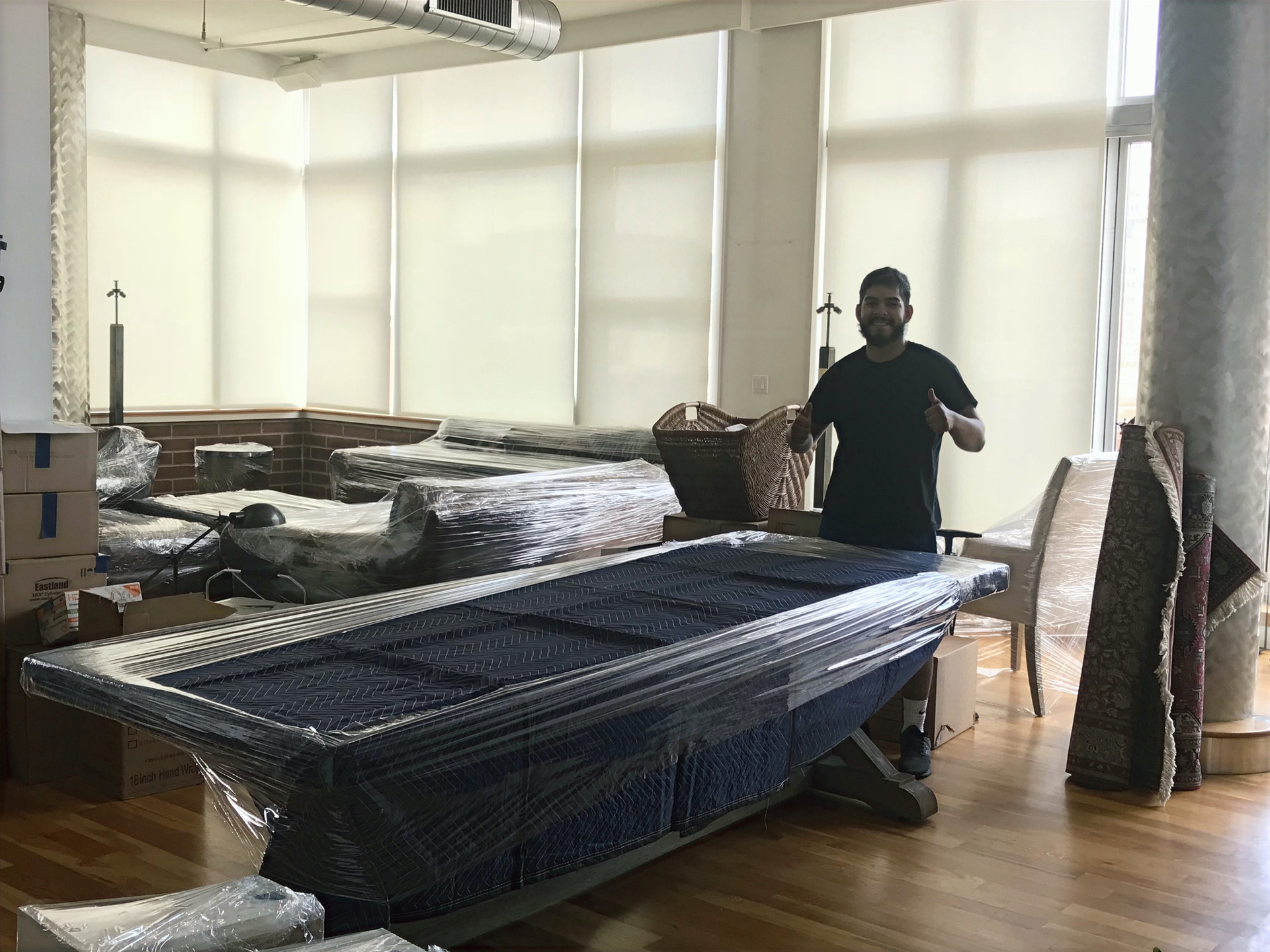 Prepping all furniture in Blankets and Plastic wrap before being moved
