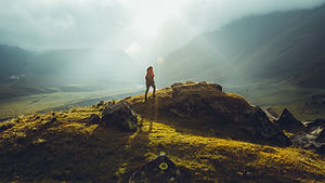 Hiker Young Woman With Backpack Rises To