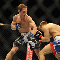 Mac Danzig looking to Land an uppercut against Takanori Gomi during their battle in China.