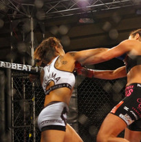 Angela Danzig lands a right hand on UFC veteran, Ashley Yoder