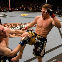 Danzig lands a knee to the chin of Mark Bocek during their fight at UFC 87 in Canada.