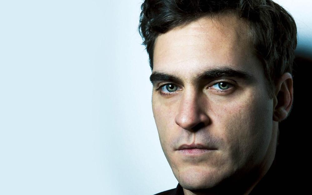 Joaquin Phoenix looking