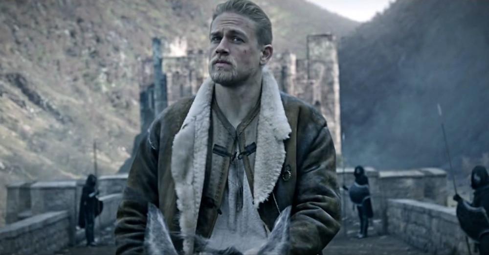 Charlie Hunnam as King Arthur on horse
