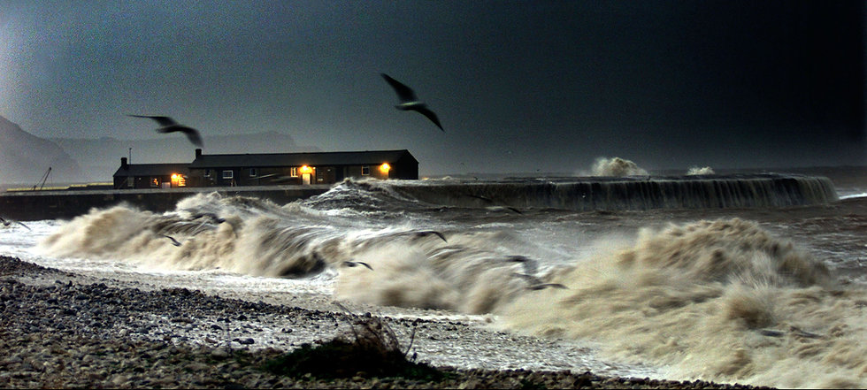 Dusk on Monmouth Beach, Lyme Regis with a heavy sea.