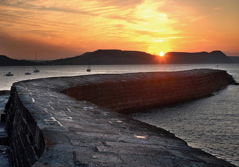 Sunrise over the Cobb, Lyme Regis.