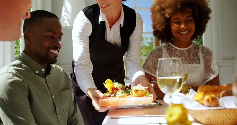 Waiter Serving Food.jpg