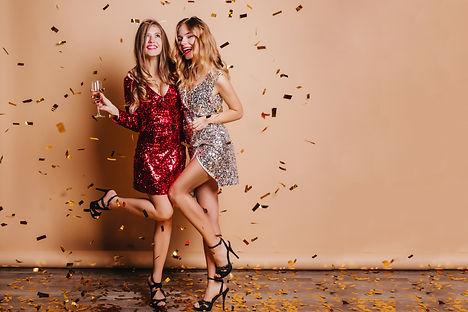 Full-length portrait of happy girls wear