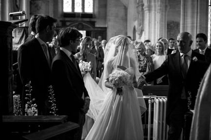 Summer Wedding Bride with flower bridal bouquet in the church