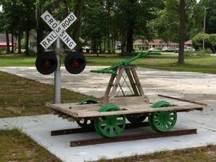 Railroad cart located in front of History Museum
