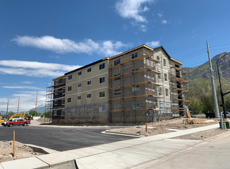 May Update: Paved parking lot with lines, landscaping prep, getting ready for you to Move In!
