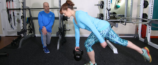 Stacy doing a single leg RDL with a kettlebell