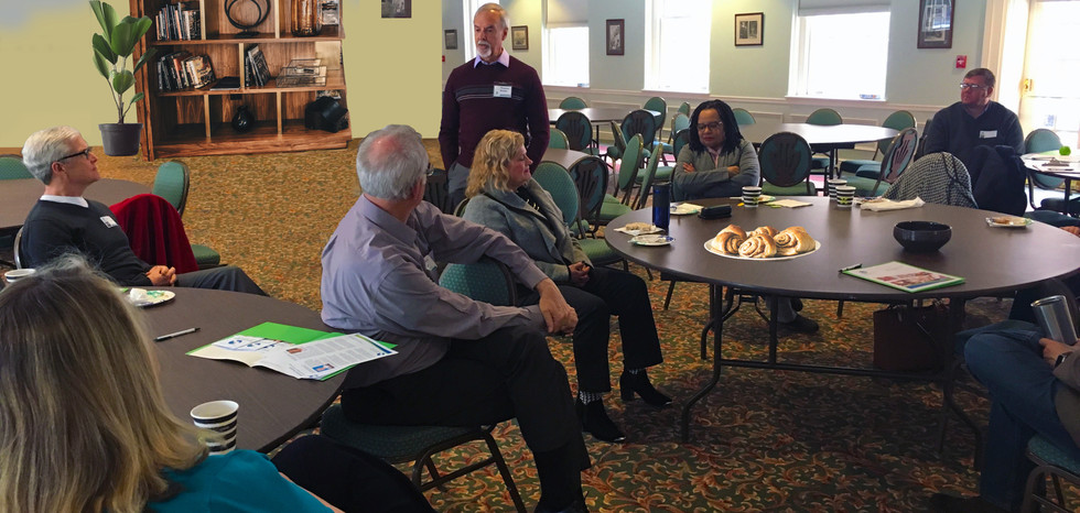 Samaritan therapist, Tom Kneier (standing) addresses pastors at our Clergy Coffee