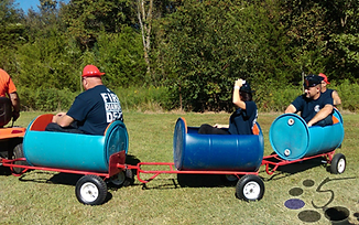 Diamond firefighters enjoying a ride aboard our 5 Stones Express barrel train.