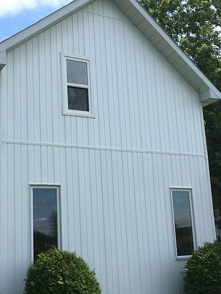 wall repaired with new siding