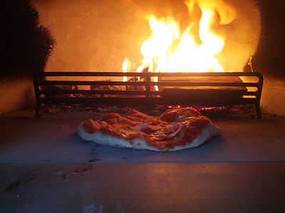 Pizza cooking in the oven