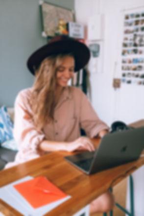 smiling-woman-using-laptop-3277920.jpg