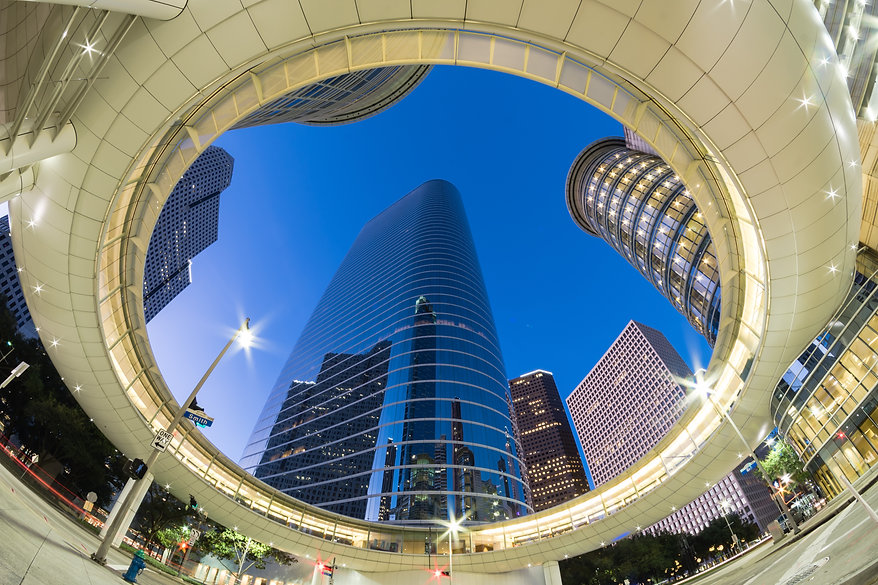 Look up view of Houston Downtown modern skyscrapers at blue hour..jpg