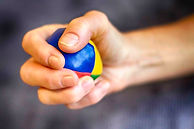 Stressball being squeezed