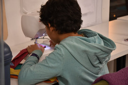 Student at sewing machine 3