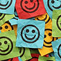 Smiley faces on coloured notes