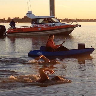Cydney Simpson escorts swimmers on their last 11 km from the Goolwa pier in South Australia with a Coast Guard escort.