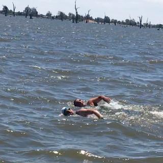 Hunter and Eric swimming across Lake Mulwala