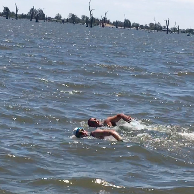 Hunter and Eric swimming across Lake Mulwala