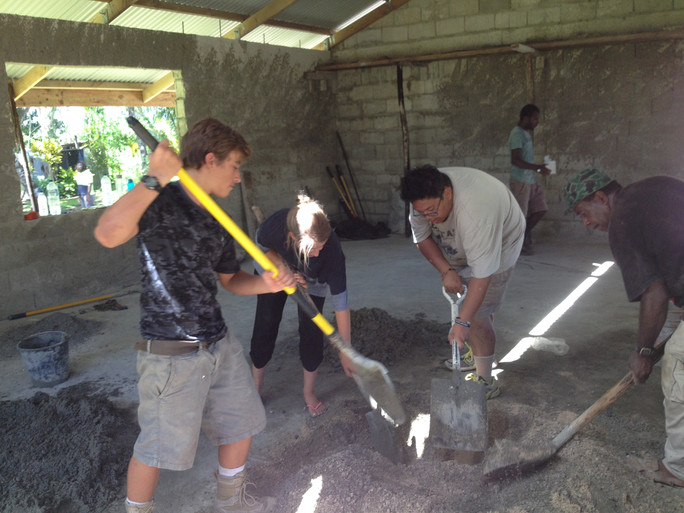 Making cement bricks for the water tank