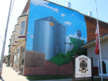 ARTIST AT WORK: A mural artist is back at it in Assumption, working on his second town project!