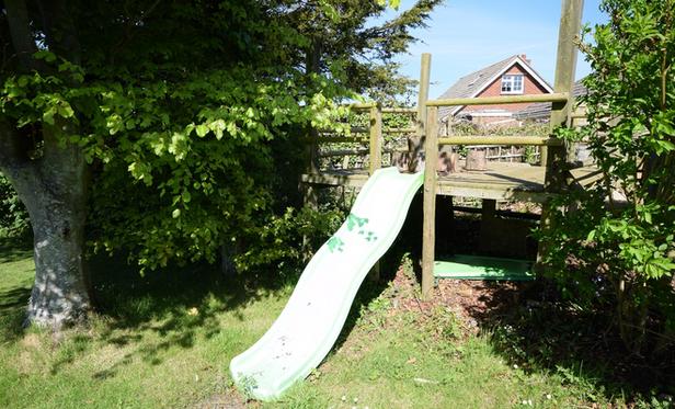 Climbing platform with slide