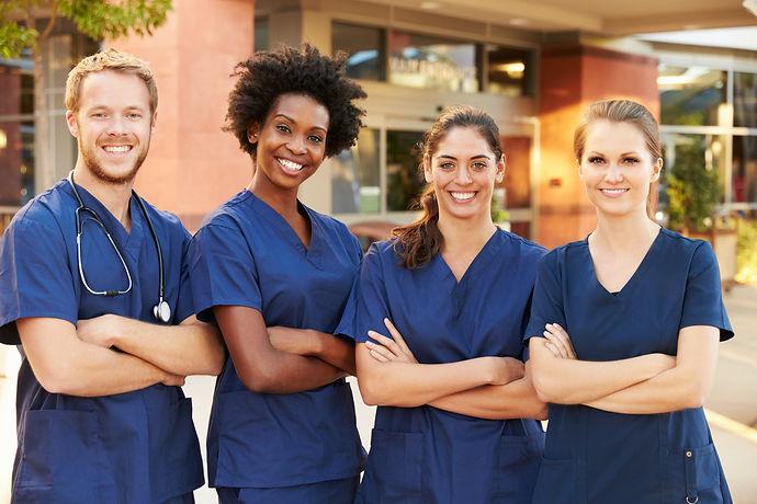 Portrait Of Medical Team Standing Outside Hospital.jpg