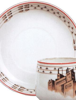 Фарфоровая чашка с блюдцем с изображение