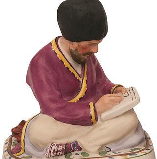 Фарфоровая статуэтка Туркмен за письмом