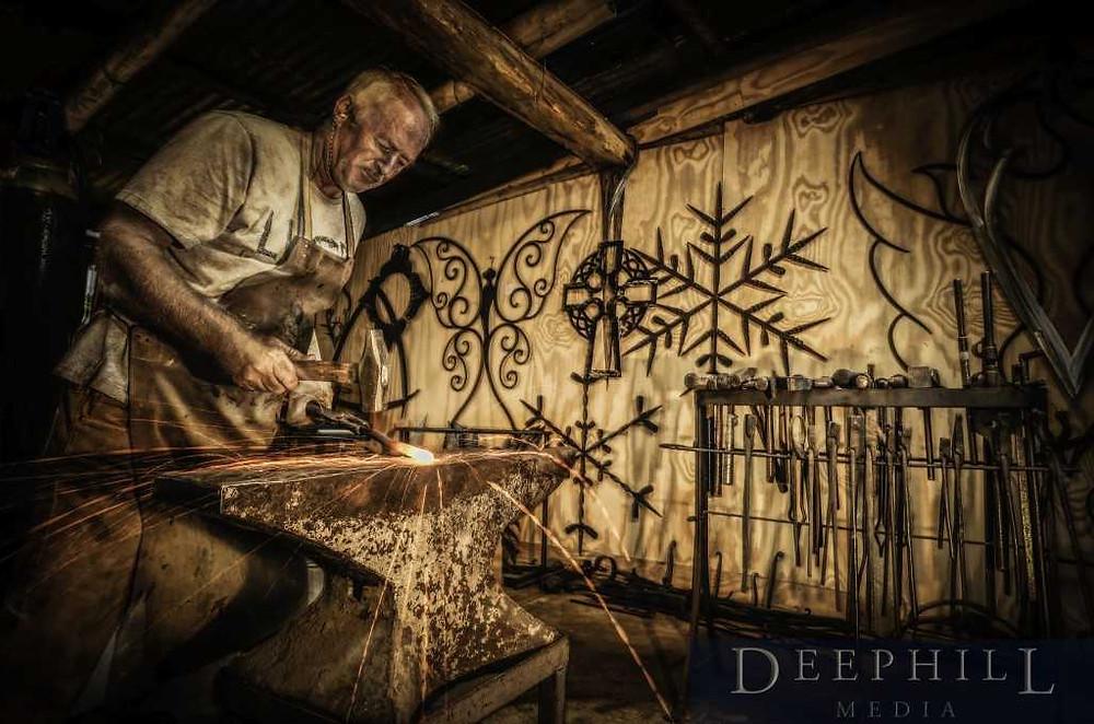 Metal artist Ron Fitzpatrick at work at Talisman Gallery.
