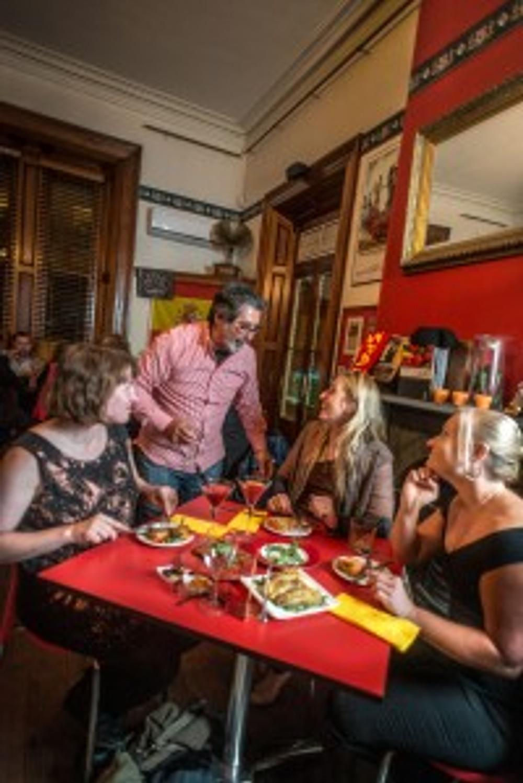Maitre'd Jose Fernandez explains each dish