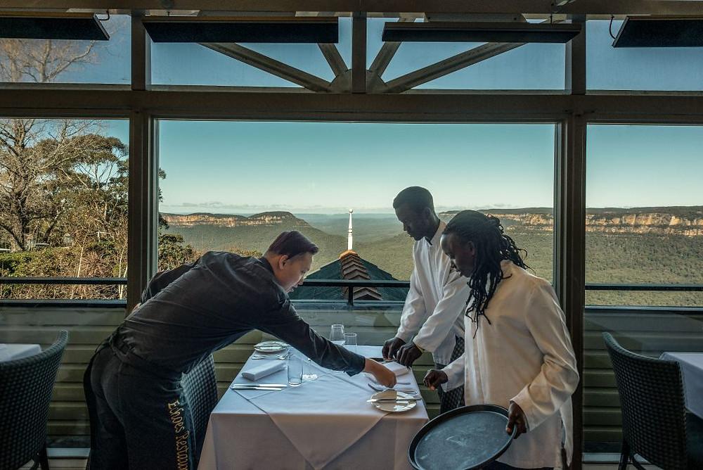 (l-r) Echoes Boutique Hotel waiter Leo Tran with Frank Kuteesa and Venerandah Nakato of Uganda.
