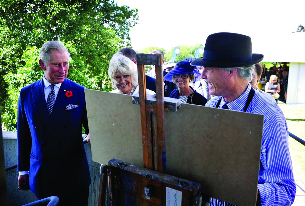 Blue Mountains artist Warwick Fuller (r) with Their Royal Highnesses The Prince of Wales and The Duchess of Cornwall during their 2012 tour to Australia